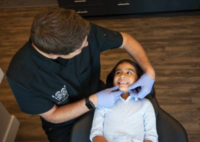 Dr. Chuck working with pediatric dental patient